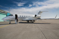 Executive business woman leaving a corporate jet plane Stock Images
