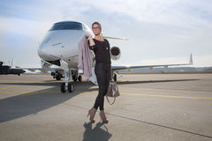 A executive business woman leaving a plane Royalty Free Stock Images
