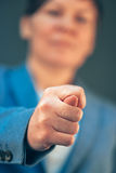 Executive business woman showing fig hand sign. To employee, selective focus stock image