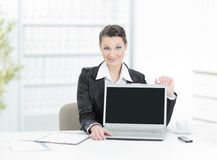 Executive business woman showing a laptop sitting at her Desk. Photo with copy space stock image