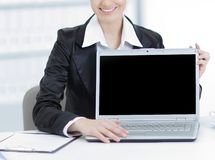 Executive business woman showing a laptop sitting at her Desk. Photo with copy space royalty free stock images