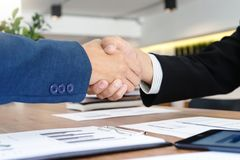 Executive businessman hand shake with another business man. Show their corporation Stock Photo