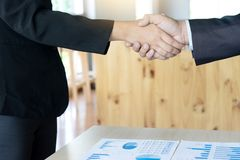 Executive businessman hand shake. With another business man show their corporation Stock Photos