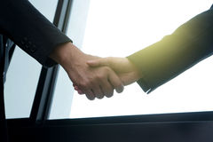 Executive businessman hand shake. With another business man show their corporation Stock Photo