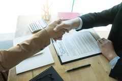 Executive businessman hand shake with another business man. Show their corporation Royalty Free Stock Images