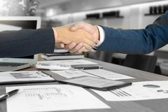 Executive businessman hand shake with another business man. Show their corporation mix color black and white Stock Photo