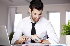 Executive businessman with laptop stock photos