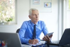 Executive businessman working in the office royalty free stock photo