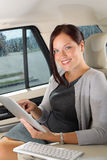 Executive businesswoman in car work touch tablet Royalty Free Stock Images