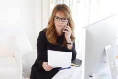 Executive businesswoman with mobile phone Royalty Free Stock Images