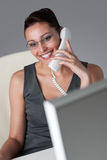 Executive businesswoman on the phone at office Stock Image