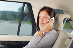 Executive businesswoman sit car backseat calling Royalty Free Stock Photos