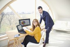 Executive businesswoman and young financial assistant businessma Stock Photo