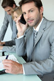 Executive on cellphone Royalty Free Stock Image
