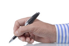 Businessman writing or signing with ballpoint pen, white background Royalty Free Stock Images