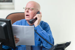 Executive comparing computer and written notes Royalty Free Stock Photos