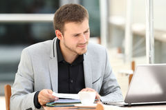 Executive comparing documents on line in a bar Royalty Free Stock Photo