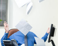 Executive at desk throws papers in air royalty free stock photo