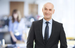 Executive director. Portrait of senior executive director standing at office royalty free stock images