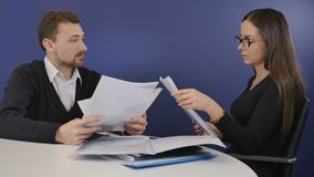 People on job interview. Executive director sits in armchair in the office and has a conversation with a young woman in eyeglasses. Attractive woman talks about stock footage