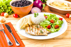 Executive dish: Grilled, rice and beans. Royalty Free Stock Images