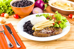 Executive dish: Grilled, rice and beans. Royalty Free Stock Photos