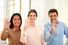 Executive ethnic team with ok sign Stock Photo