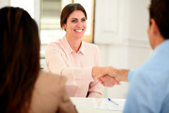 Executive female giving a hand greeting Royalty Free Stock Photos