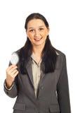 Executive female holding light bulb. Happy executive woman holding light bulb isolated on white background Stock Image