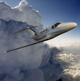 Executive in flight near a storm Stock Photo