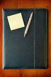 Executive Folder with note and pen Stock Photos