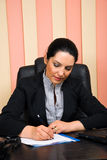 Executive formal woman working in office Stock Photos