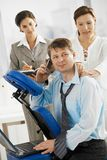 Executive getting massage in office Stock Image