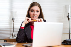 Executive girl seems confused at work Stock Photo