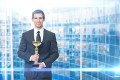 Executive with golden cup Stock Photos