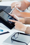 Executive hands with digital tablet in a financial meeting Stock Image
