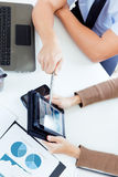 Executive hands with digital tablet in a financial meeting Stock Photo