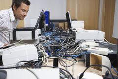Executive And Hardware Mess In Office Royalty Free Stock Image