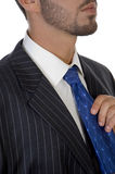 Executive holding his tie Royalty Free Stock Photo