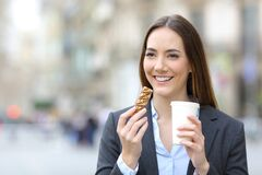 Free Executive Holding Snack Bar And Takeaway Coffee In The Street Stock Images - 176595514