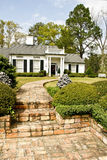 Executive home with brick walkway Royalty Free Stock Image