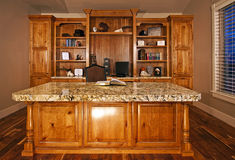 Executive home office. New executive home office with a modern custom cabinets and bookshelves Royalty Free Stock Photos