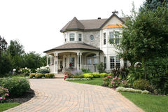 Executive House with unistone driveway Royalty Free Stock Image