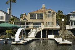 Executive house on the water. Executive home in a housing commuinity in Northern California with waterfront access to the delta Royalty Free Stock Photos