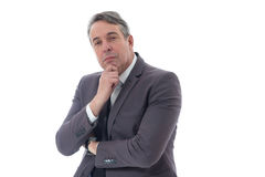 Free Executive Is Holding His Chin Up And Assessing Something. Middle-aged Man With Hand On Chin. Executive In Suit On White Background Royalty Free Stock Image - 98204906