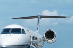 Executive jet aircraft. White, two-engine executive jet aircraft on the ground with door open Stock Photos