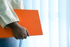 Executive job. Executive with hand on office clipboard royalty free stock images
