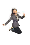 Executive jumping and show victory sign. Executive woman jumping and showing victory sign hand isolated on white background Stock Photo