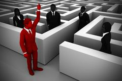 A skilled leader guides the team out of a maze. An executive leader helps the team find their way out of a complex maze Royalty Free Stock Image