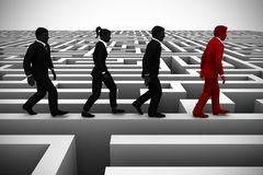 A bright leader guides the team out of a maze. An executive leader helps the team find their way out of a complex maze using his unique intelligence Royalty Free Stock Images